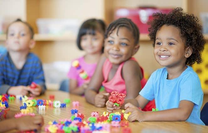 kindergarten children playing with toys
