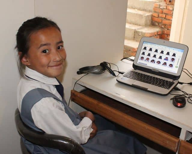 Nepalese student using Waterford on laptop
