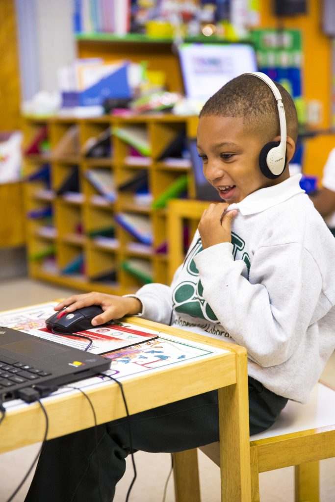 boy using Waterford on desktop computer
