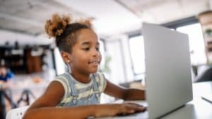 girl watching back to school night on laptop