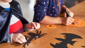Preschool-aged children making crafts for Halloween