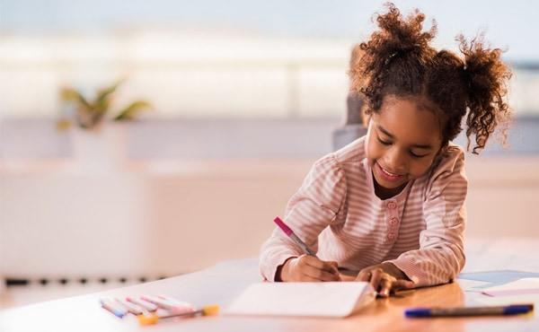 Child writing in her gratitude journal. Gratitude can help children be happier and healthier.