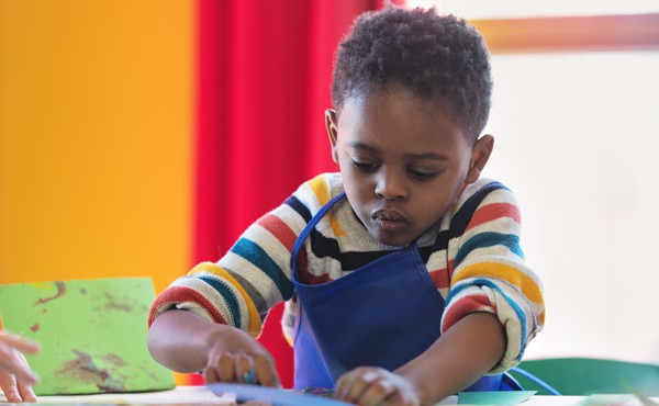 Boy doing winter crafts. Find holiday crafts for children