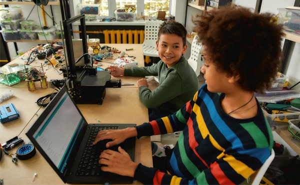 Two students work together on coding and other STEM activities