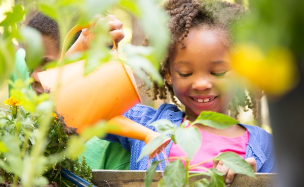 A girl in her garden. Gardening is a fantastic way for children to connect with nature.