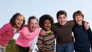 A group of happy, confident kids. Find out how you can help your child grow up confident.