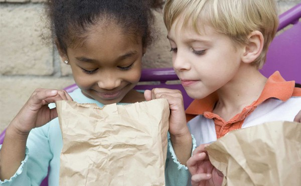 Children share a lunch. Find help getting nutrition for your family
