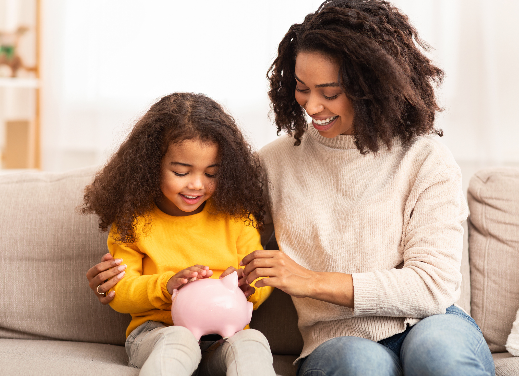 mom and child family financial literacy budgeting