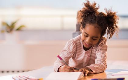 Girl writing at her desk